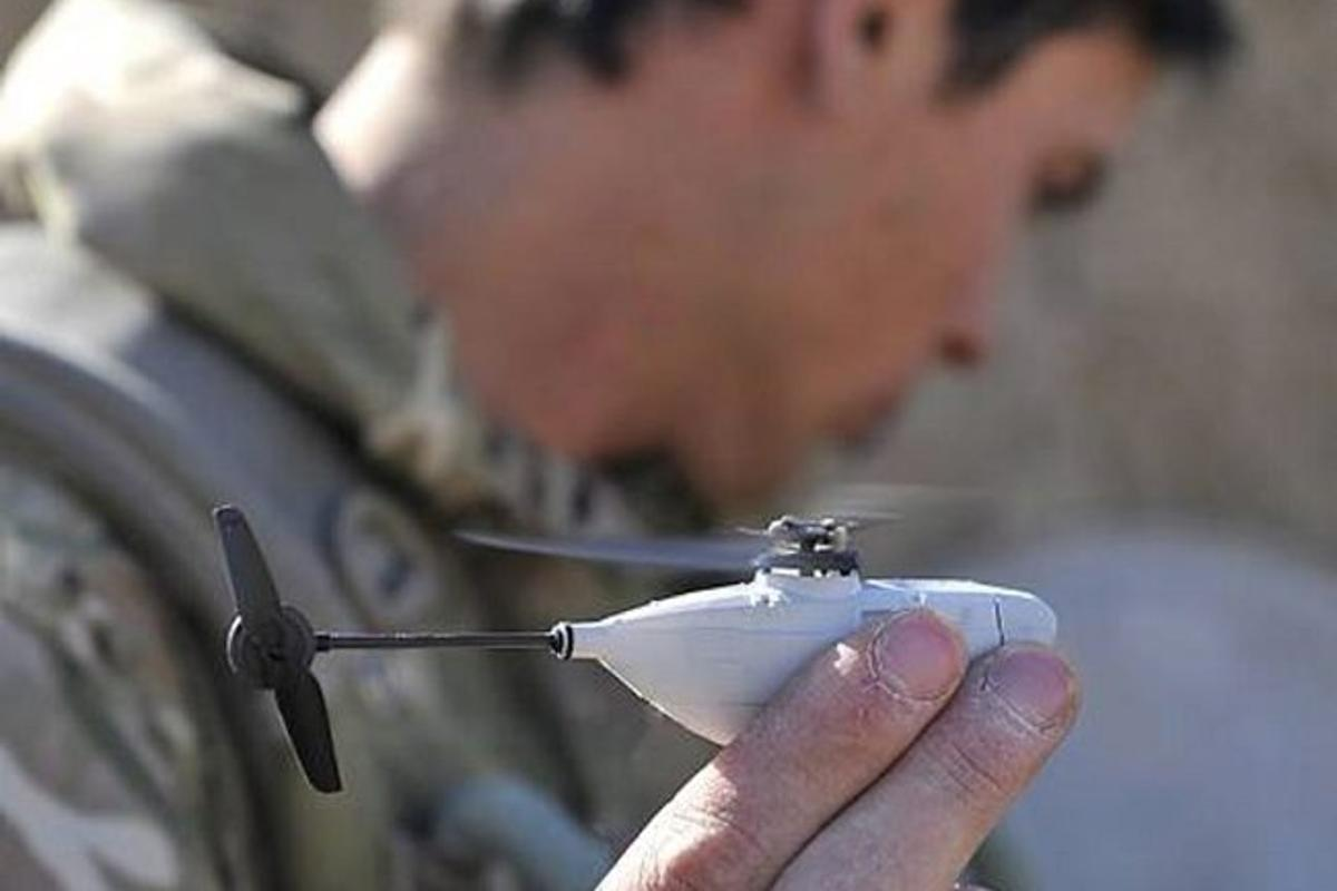 British soldiers in Afghanistan have been issued palm-sized Black Hornet Nano UAVs to scout around corners and obstacles for hidden dangers [Image: © Crown copyright]