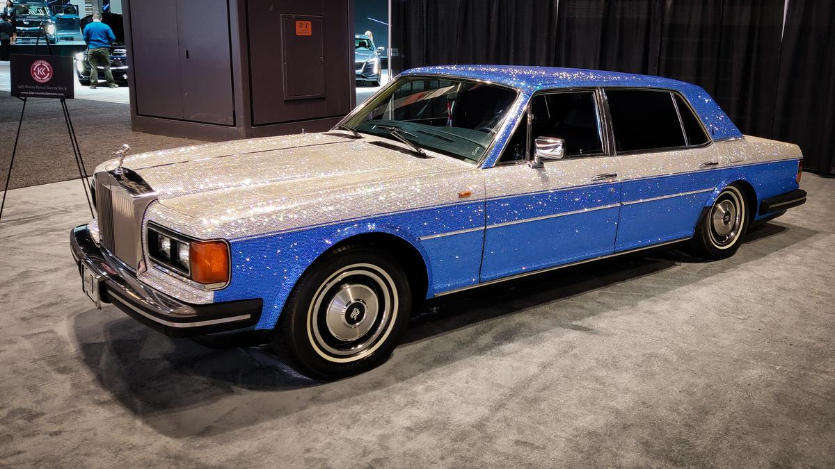 This gem-encrusted 1983 Rolls Royce speaks to everyone's inner Liberace, sparkling from every angle