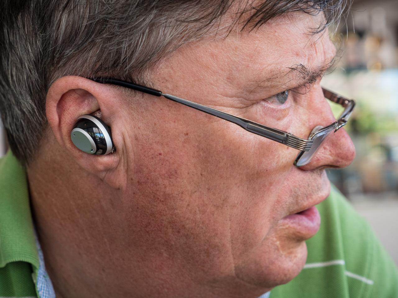 The author's (slightly hard of hearing) dad wearing IQbuds