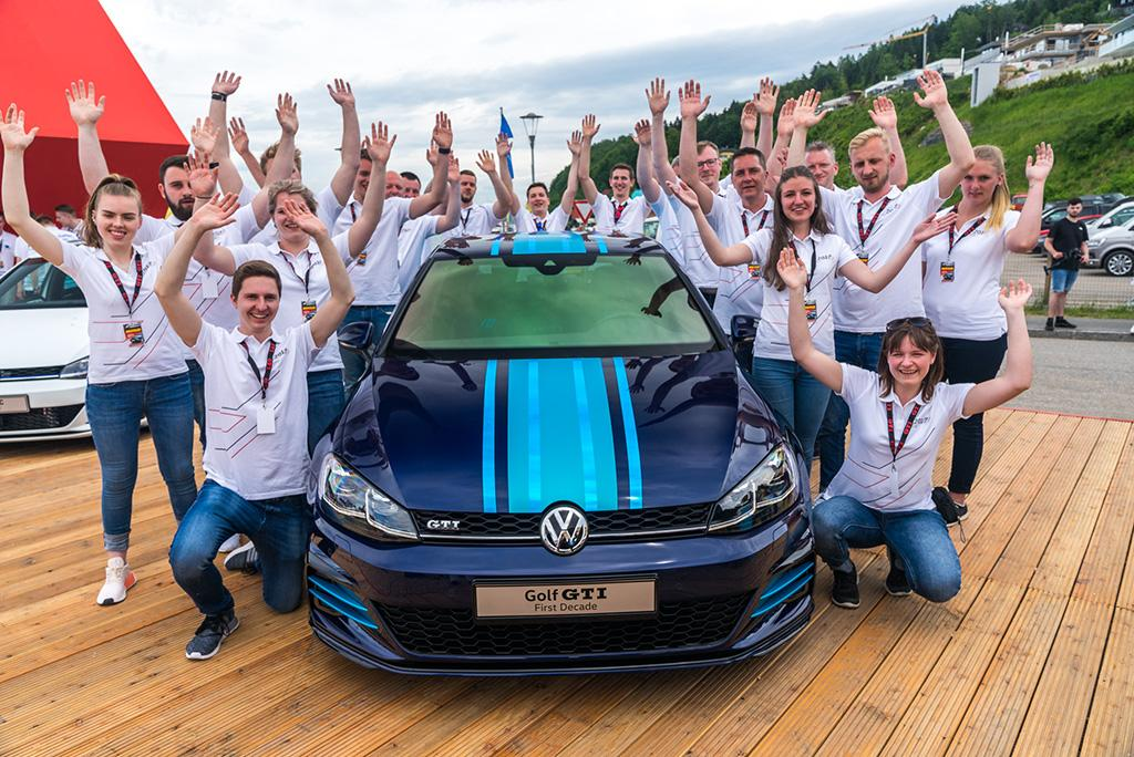 VW apprentices pose with the Golf GTI First Decade