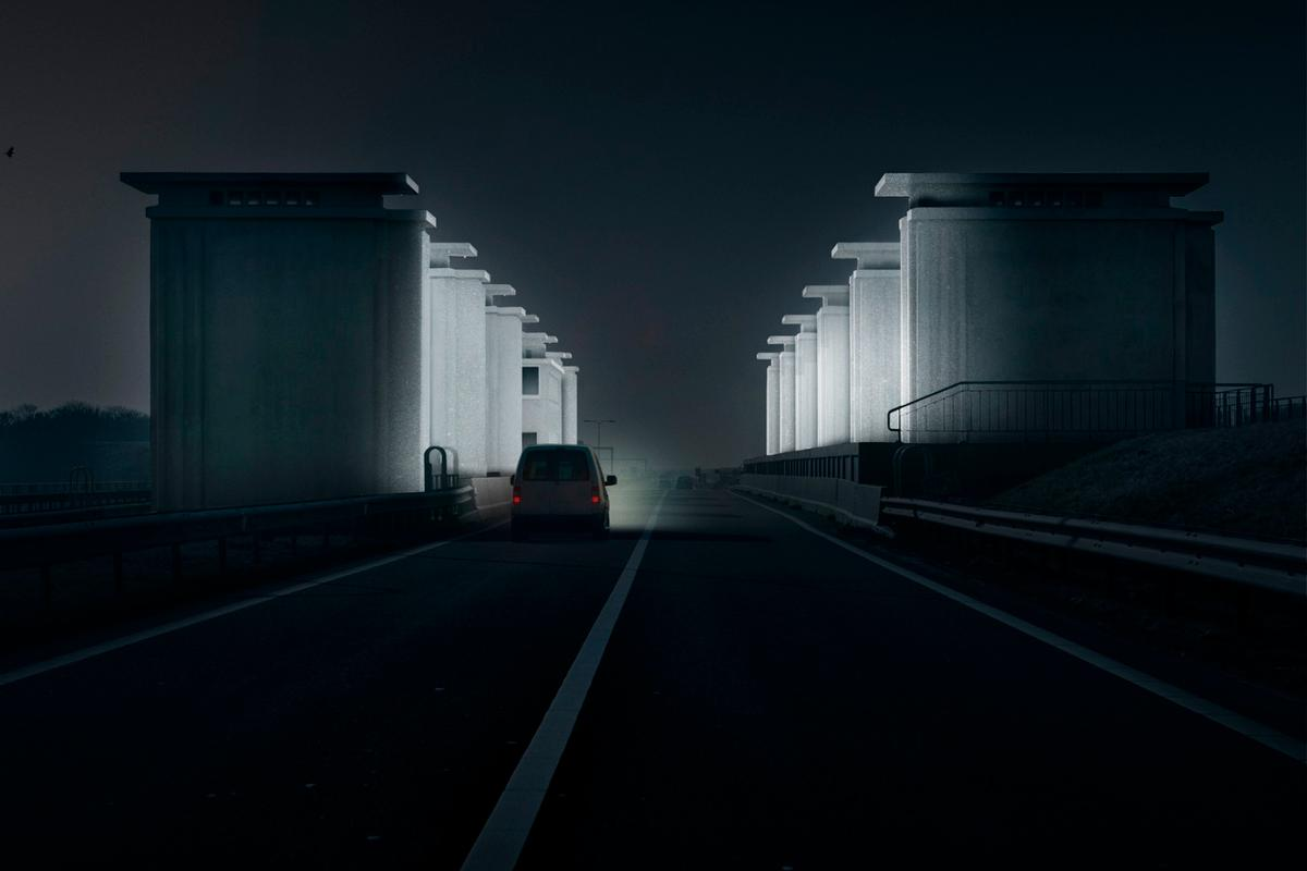 """Gates of Light"" sees the concrete of the Lorentz and Stevin lock complexes covered in a retroreflective layer, which will subsequently be lit up by the headlights of passing cars"
