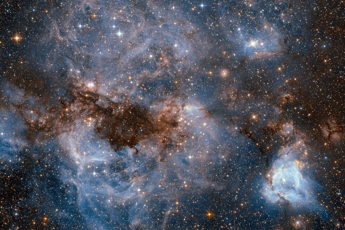 The powerful stellar winds emitted by the young stars created within N159 have worked to sculpt the nursery into the chaotic region see here