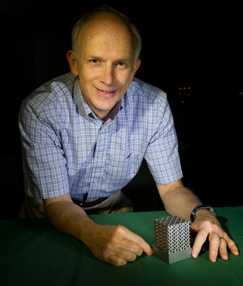 NASA technologist Tim Stephenson with a structure made of Invar (Photo: NASA Goddard/Bill Hrybyk)