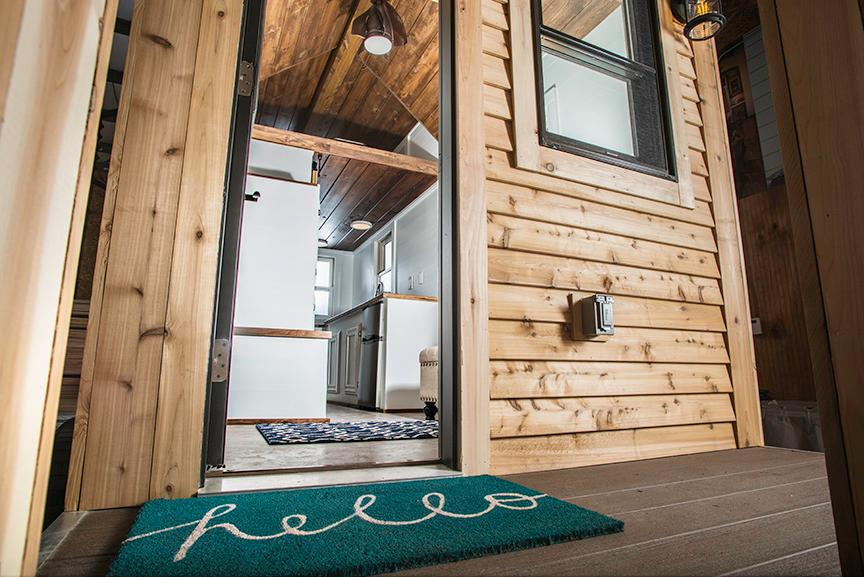 The Roving tiny house comprises a total floorspace of 154 sq ft (14 sq m) and sits on a trailer for easy towing
