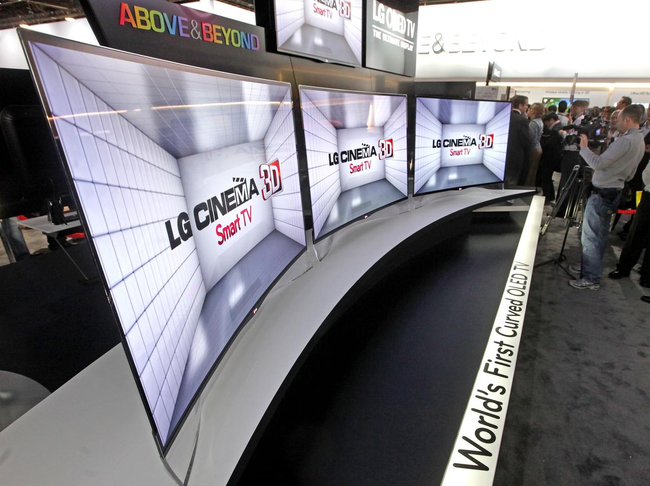 Three of LG's new 55-inch EA9800 curved OLED TV were positioned before a sign introducing them as the world's first curved OLED TVs
