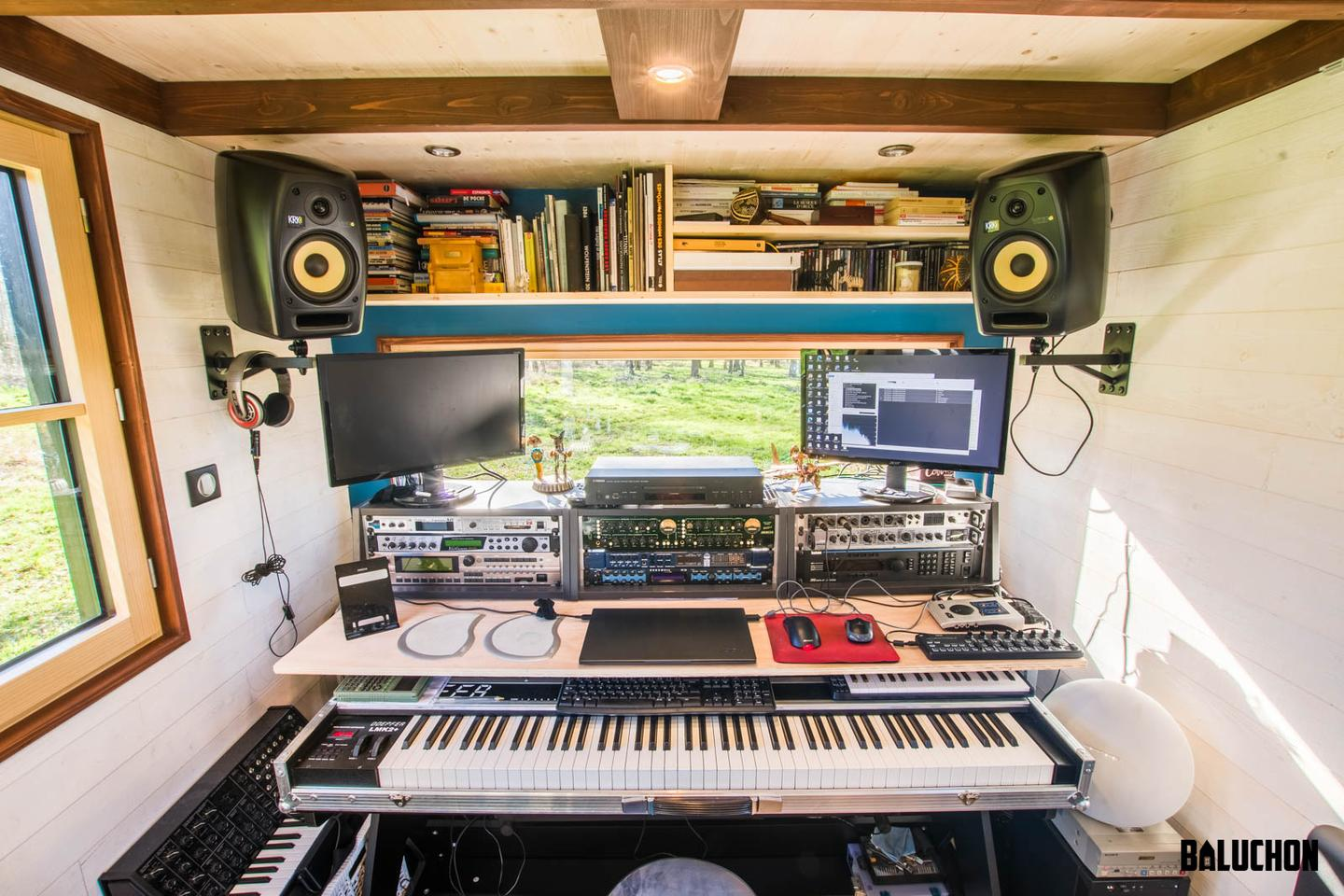 Tiny House Rhapsodie includes a home music studio setup in the living room