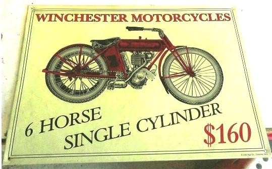 The Winchester motorcycle was powered by a Marsh Metz engine. It was advertised in its day with metal store signs such as this one, and special edition pocket watches.