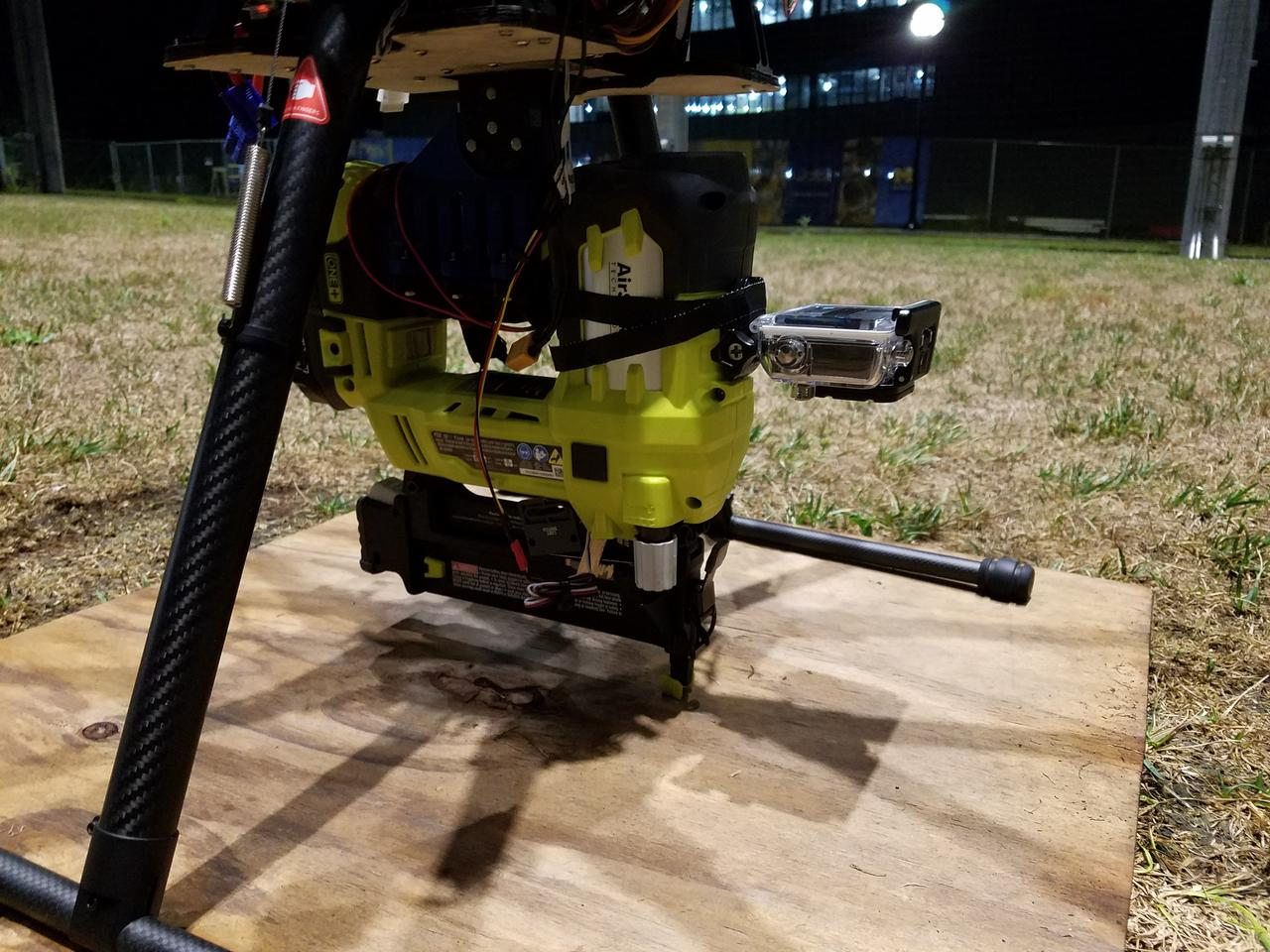 Scientists at the University of Michiganhave demonstrated an octocopter equipped with a nail gun and a knack for fixing asphalt shingles to a mock rooftop