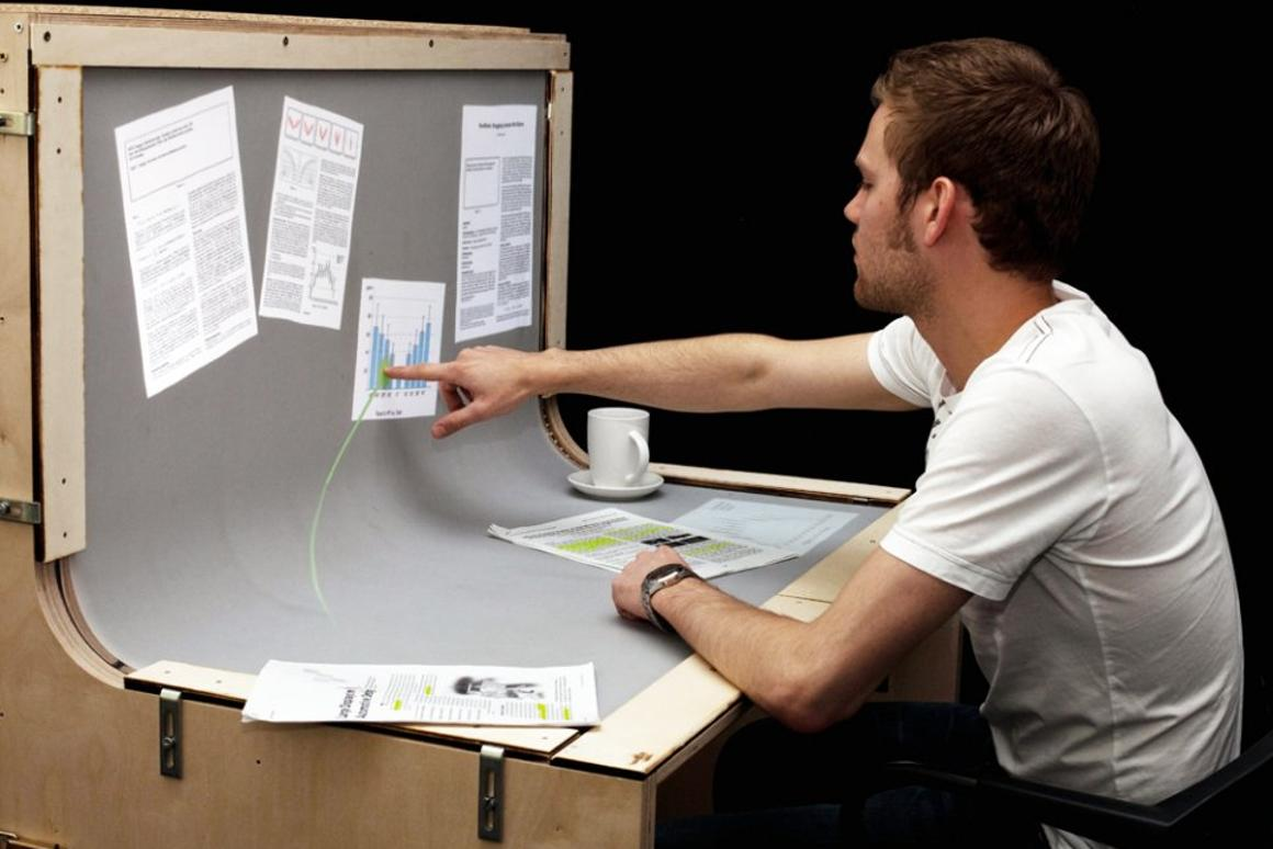 BendDesk renders the horizontal desktop and vertical display screen into one multi-touch surface via a curve in the middle