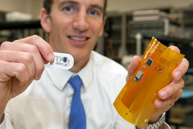 Prof. Jason Heikenfeld with the prototype patch (left) and the upcoming Bluetooth version (Photo: University of Cincinnati)