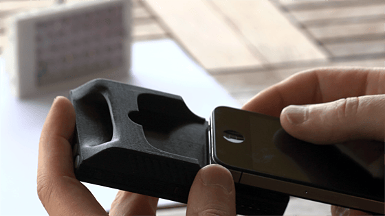 The Kick, which can hold an iPhone in a slot on the rear while leaving the camera lens exposed