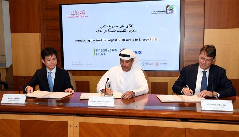 The directors of partner companies Hitachi Zosen Inova, Dubai Municipality and Besix Group, signing the agreement to build the world's largest waste-to-energy plant