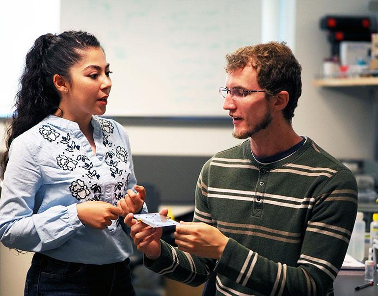 Graduate students Kiana Mirshahidi and Ben Wiltshire, with one of the sensors