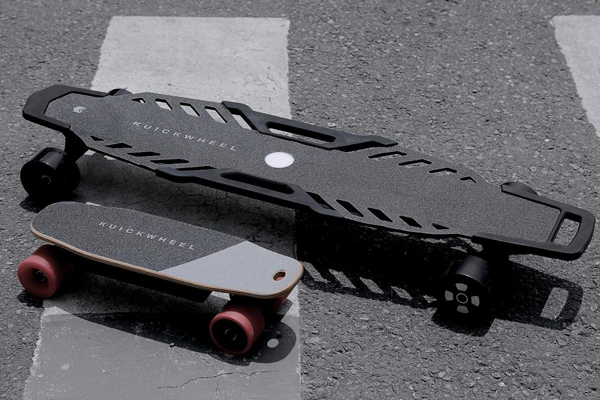 The Serpent-C (bottom left)and Serpent-W electric skateboardsfromKuickwheel