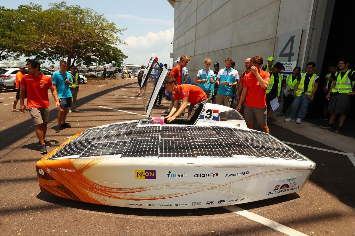 Members of the Nuon Solar Team tend to their Nuna9 solar car