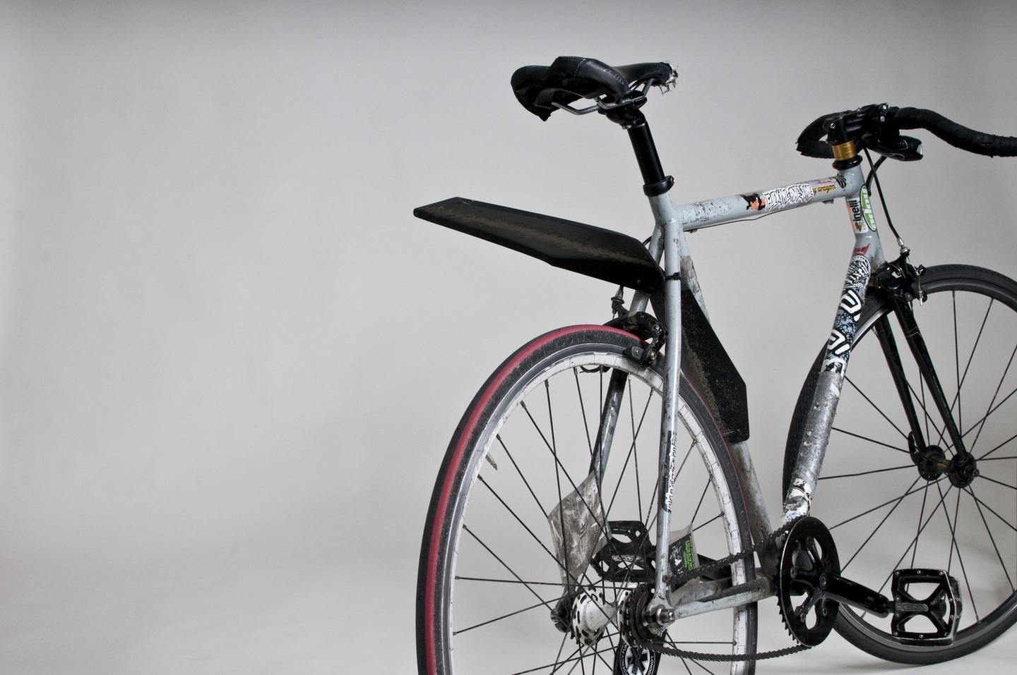 The QuickFix mudguard attaches to a bike in seconds, and packs flat when not in use