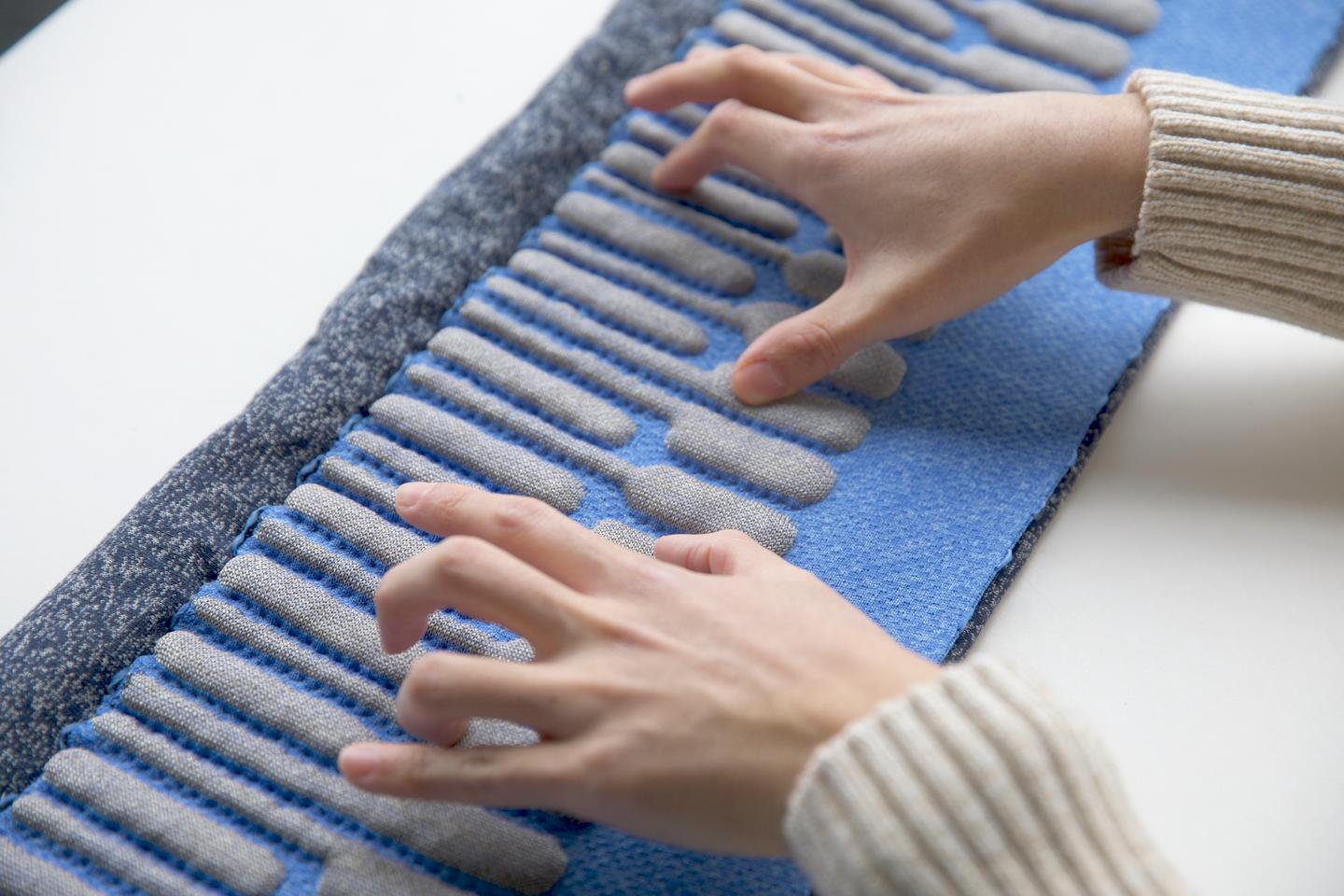 The KnittedKeyboard II can sense physical contact and gestures in the air