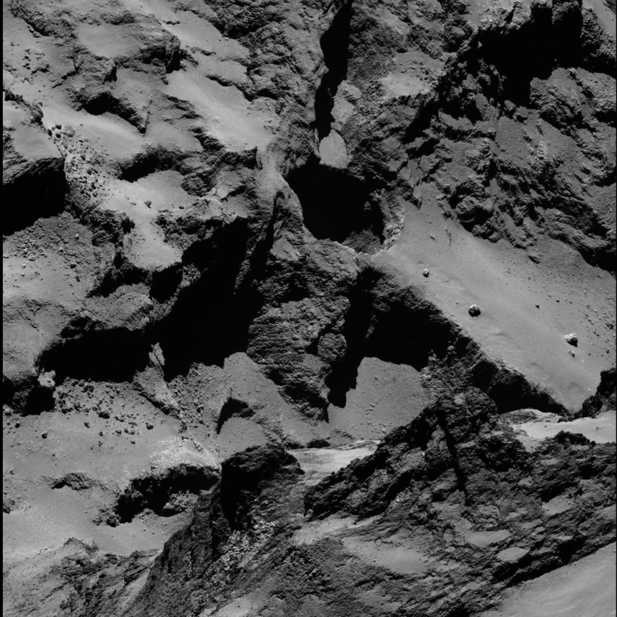 An active sinkhole (center) on 67P