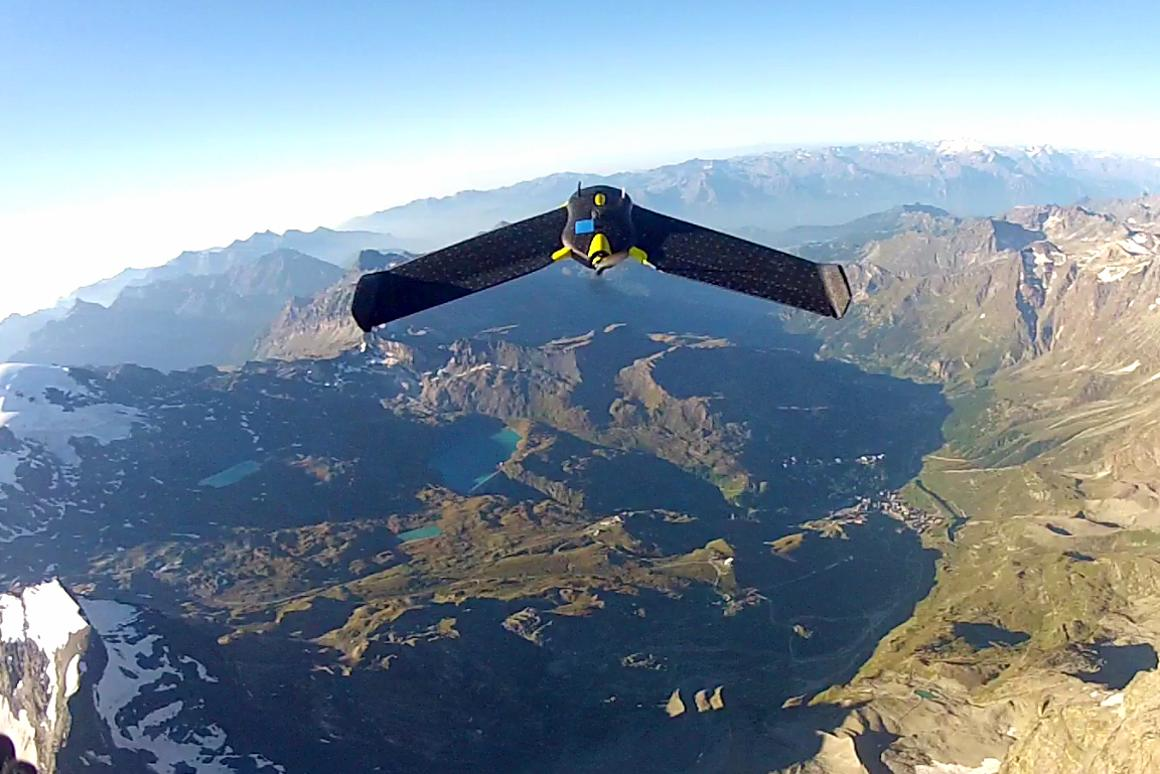 An eBee drone sails over the Matterhorn, acquiring data and taking pictures