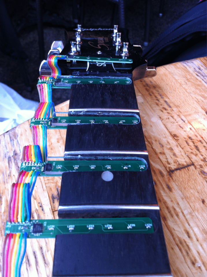 Lining up Tabber's LED lighting modules with holes cut into the neck of the host guitar