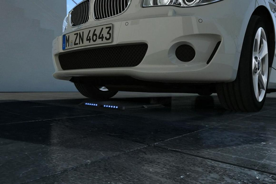 The BMW charging system uses a primary coil in the floor and a secondary coil in the car