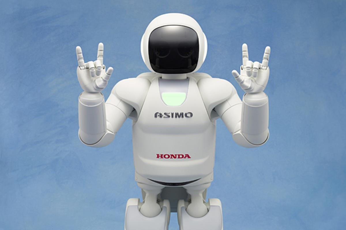 """The new ASIMO making the Japanese sign language symbol for """"I love you"""""""