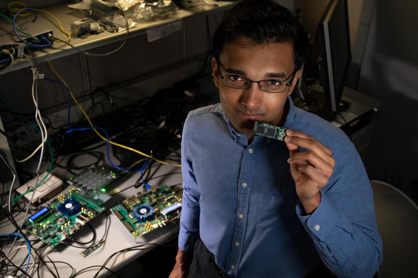 Intel Labs' Nabil Imam holds a Loihi neuromorphic test chip in his Santa Clara, California, neuromorphic computing lab