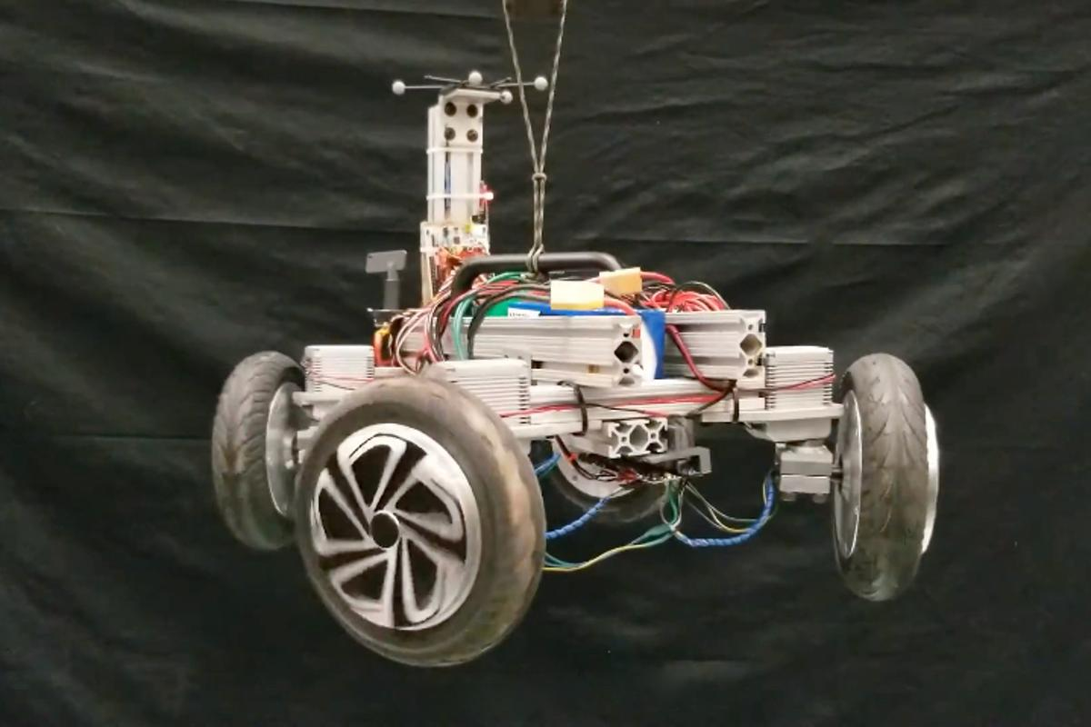 The AGRO robot, hung in the air to demonstrate its wheel-spinning/wheel-pivoting action