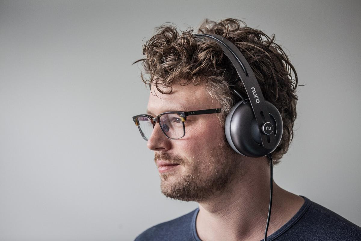 Nura co-founder Kyle Slater with his revolutionary headphones, which measure the sensitivity of your ears across a range of frequencies and give every listener a unique EQ profile for each ear