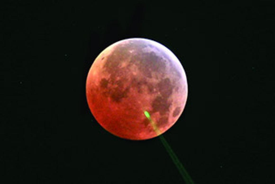 Lunar ranging laser pulse scattering off high terrestrial cloud during eclipse (Photo: NASA)