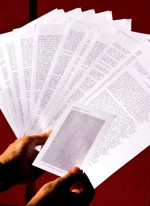 With text written only 1/100th of an inch high, 26 pages of 10-point text can be squeezed onto a 5 by 8-inch card. Xerox scientists developed the new MicroText Specialty Imaging Font so that important documents can be customized with super-small words and