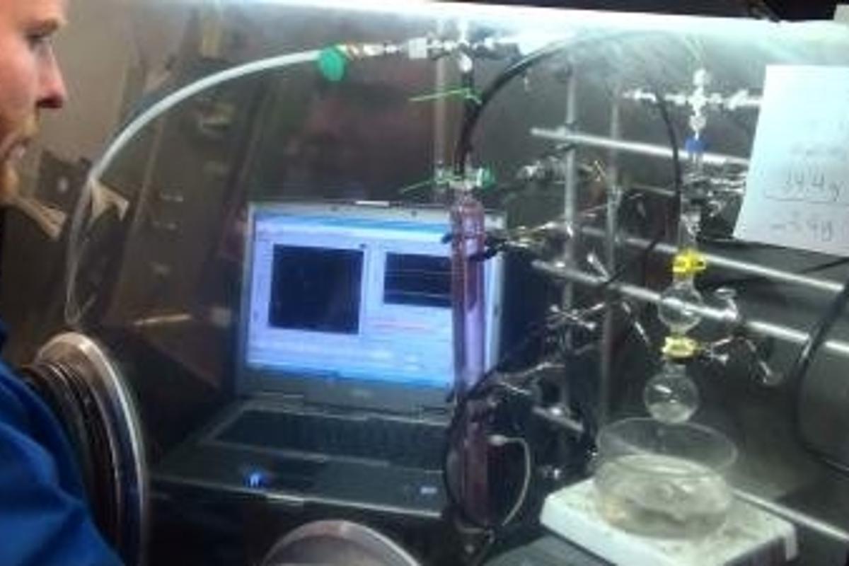 Scientist David Heldebrant demonstrates how Reversible Acid Gas Capture removes acid gases from power plant emissions