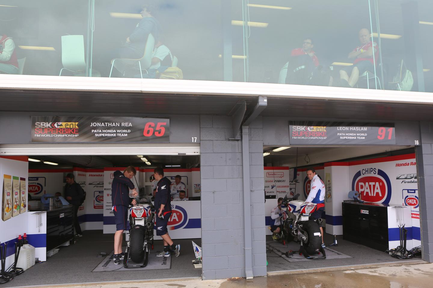Honda's PATA World Superbike team below, and Honda corporate hospitality above