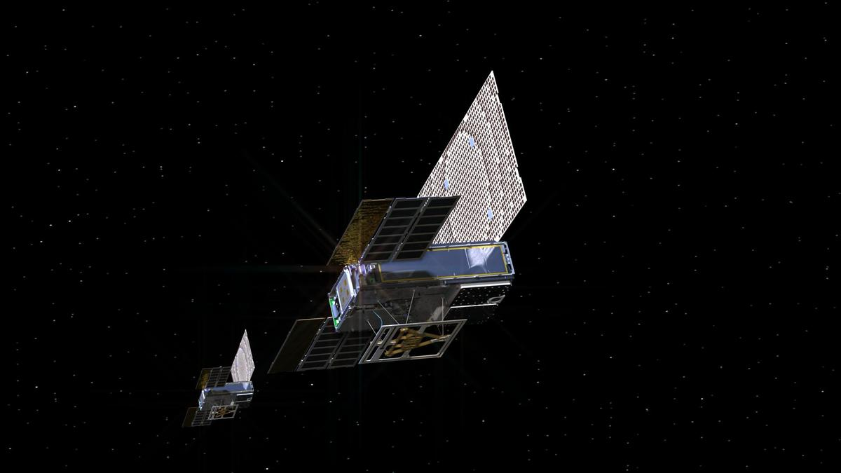 An artist's rendering of the twin Mars Cube One (MarCO) spacecraft as they fly through deep space