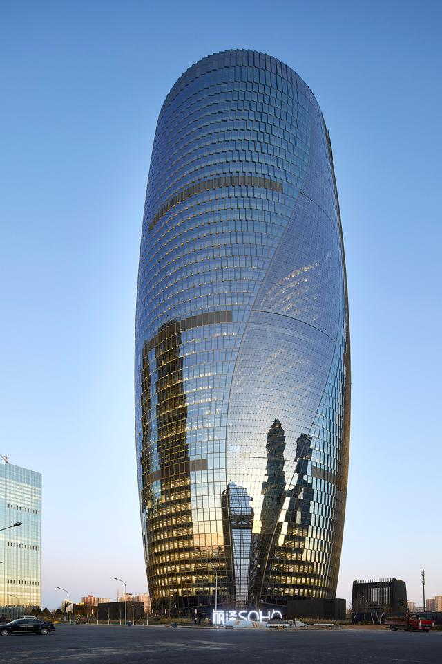 Leeza Soho rises to a height of 207 m (679 ft)
