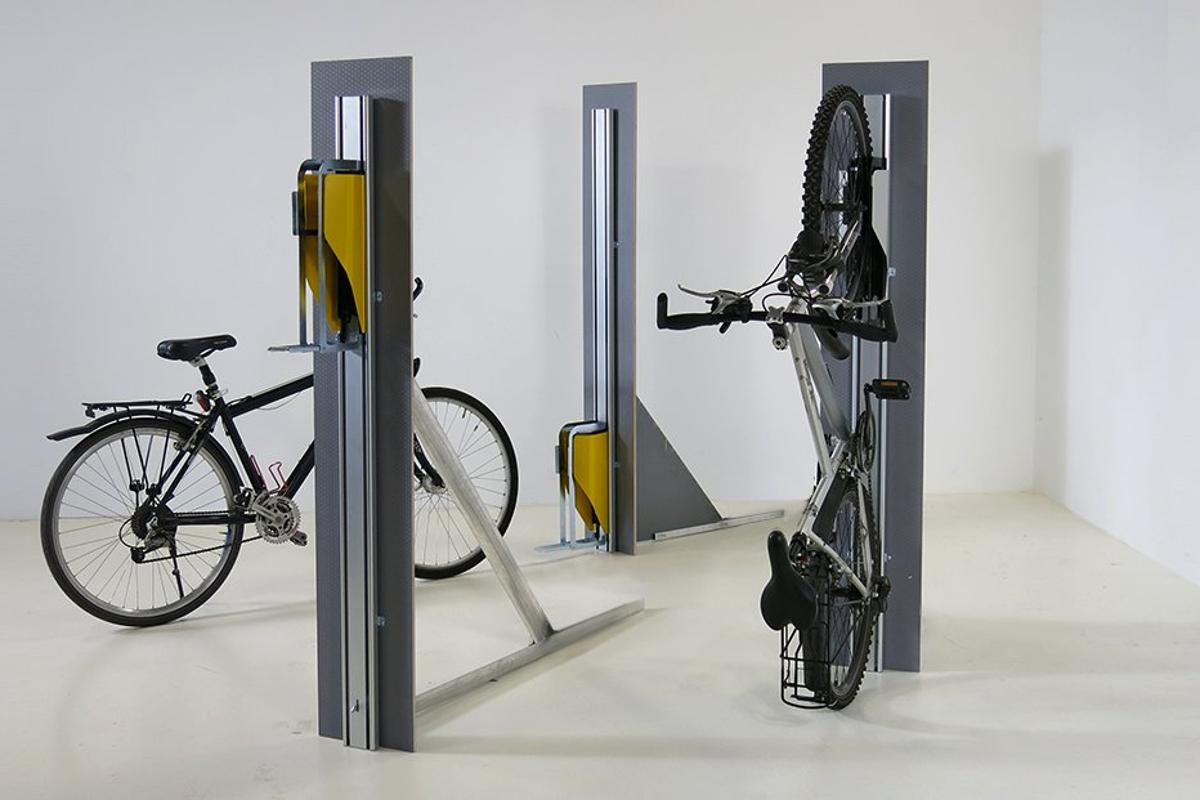 Parkis (pictured here standing free) pulls bikes up the wall