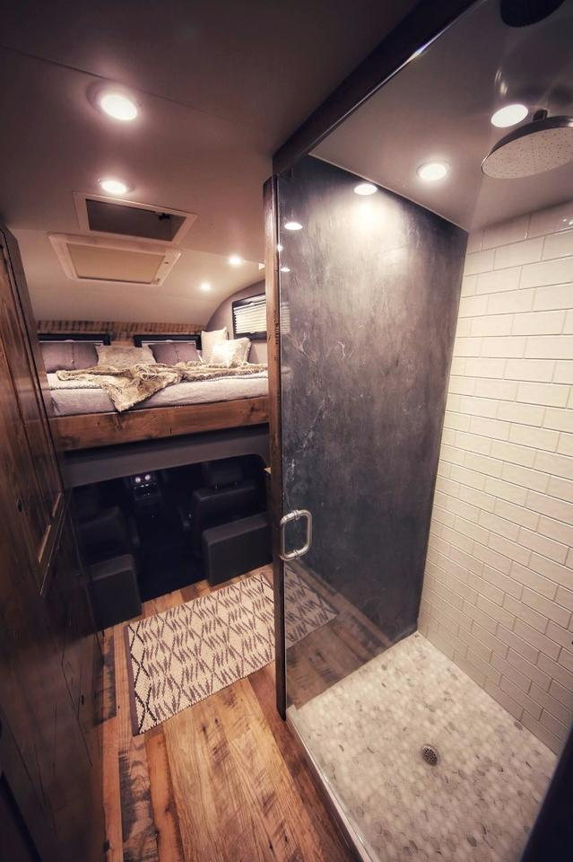Alook at theEarthRoamer XV-HD shower room and peek into the above-cab bed