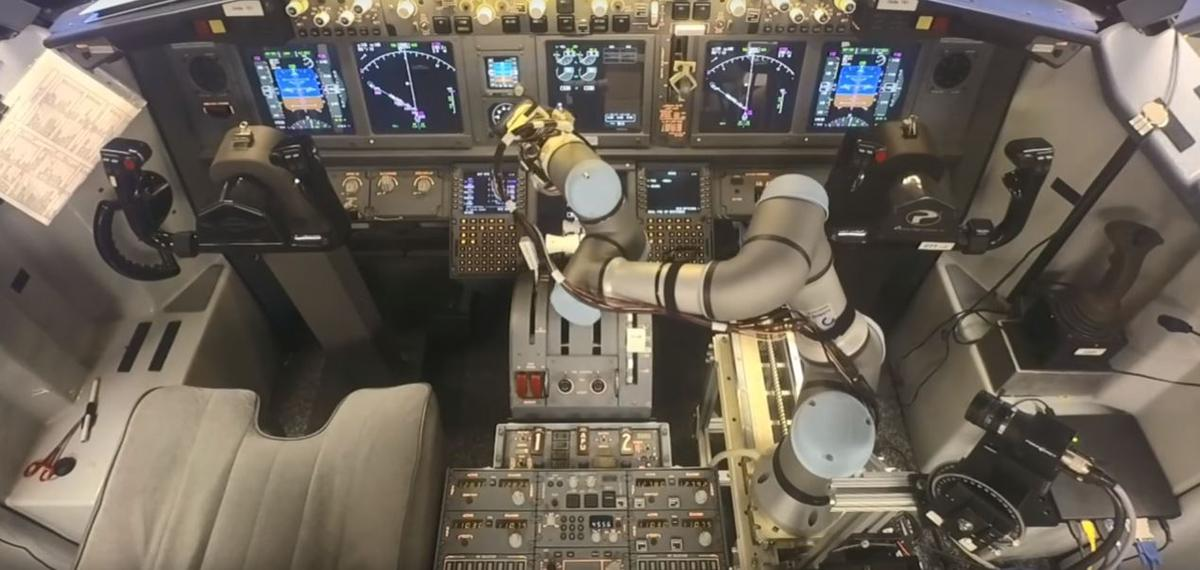 The ALIAS system operating the 737 controls using a robotic arm