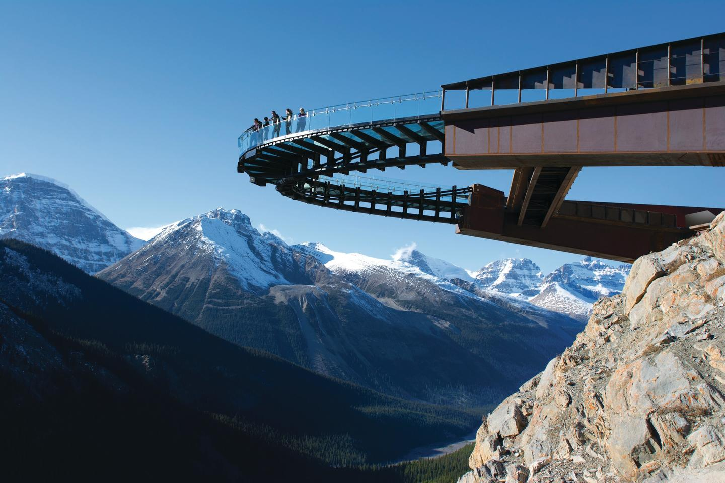 The award winning design features an impressive curved glass-floored walkway which is suspended 280 meters (918 feet) above the Sunwapta Valley (Photo: Brewster Travel Canada)
