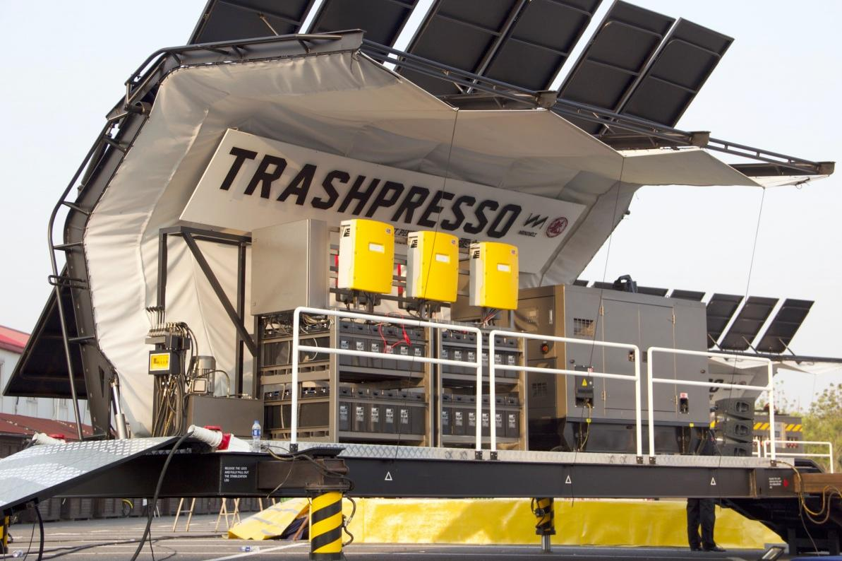 The Trashpresso is a semi-portable recycling center, that can turn discarded plastic and fabric waste into tiles