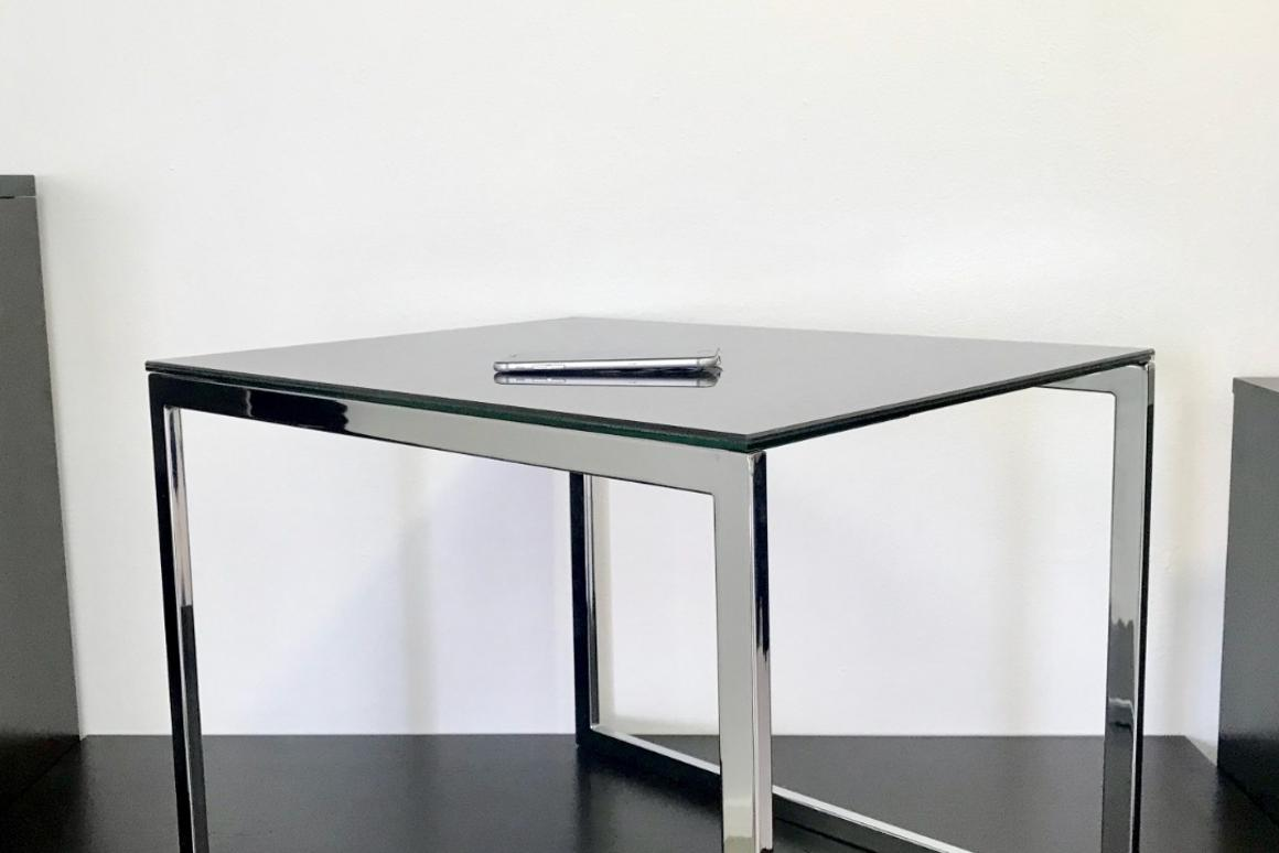 The Ebörd is a table with a surface that can harvest sunlight and wirelessly charge devices