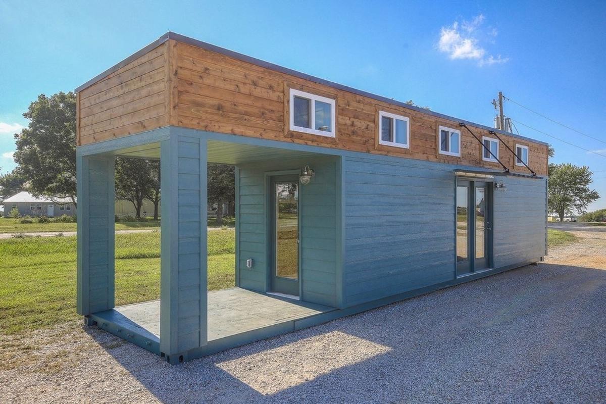 The container home is constructed from a single shipping container that has been extended in height to make room for two lofts