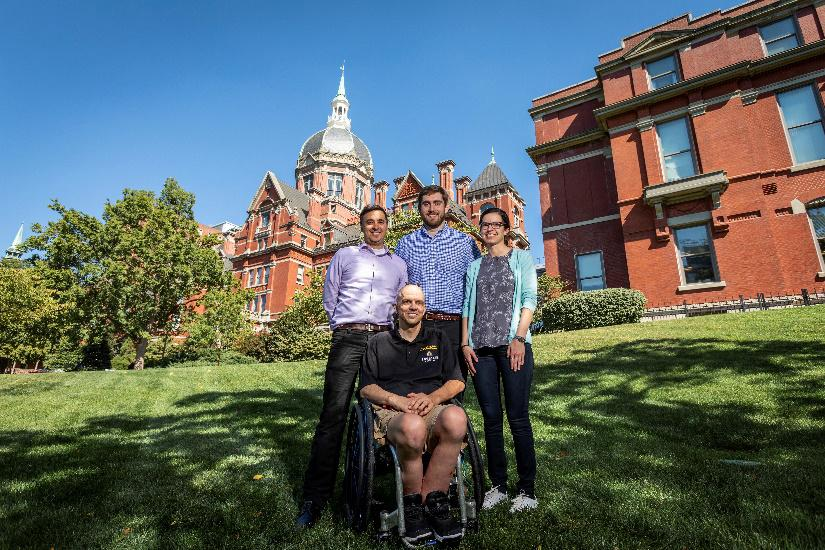 Spinal cord injury patient Buz Chmielewsk with the Johns Hopkins University research team