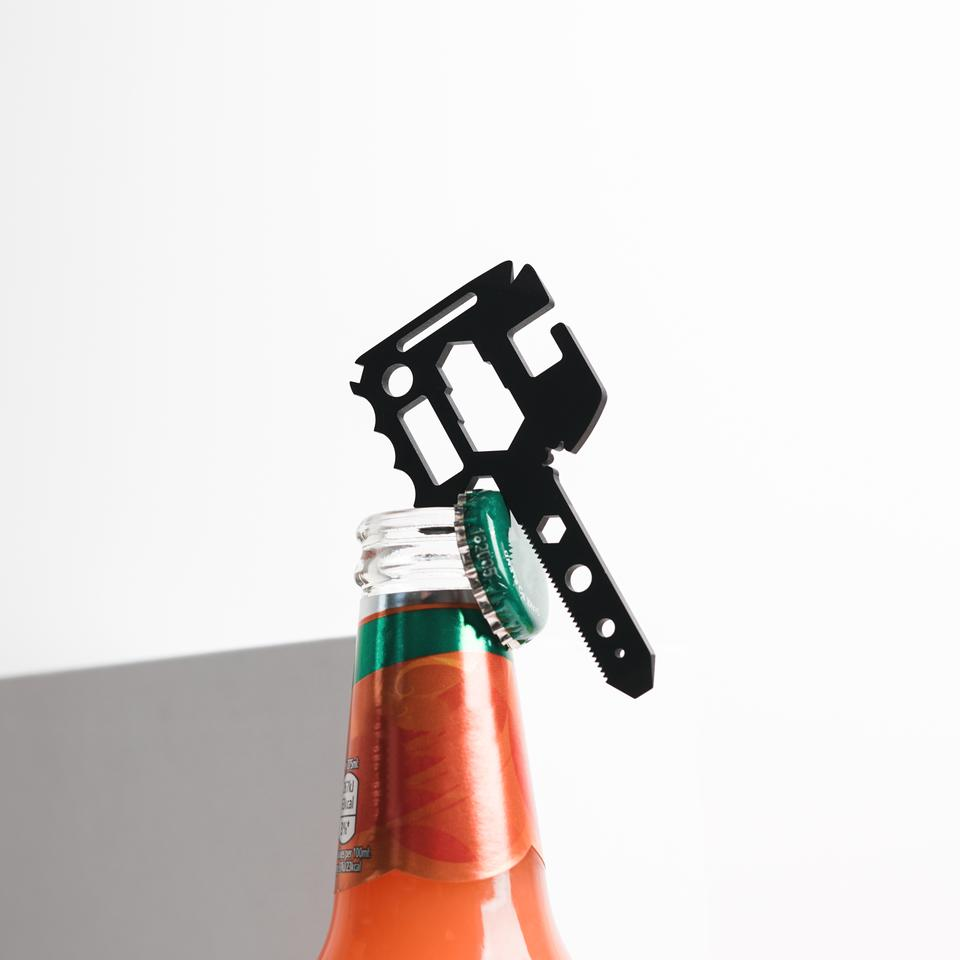 Disc's MultiKey multitool in action as a bottle opener
