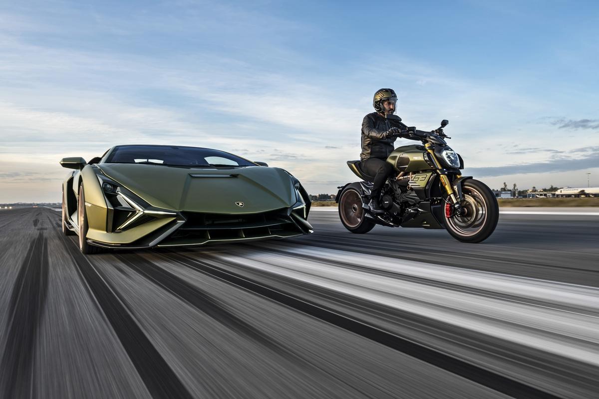 The 2021 Ducati Diavel 1260 Lamborghini in action alongside the Sián FKP 37