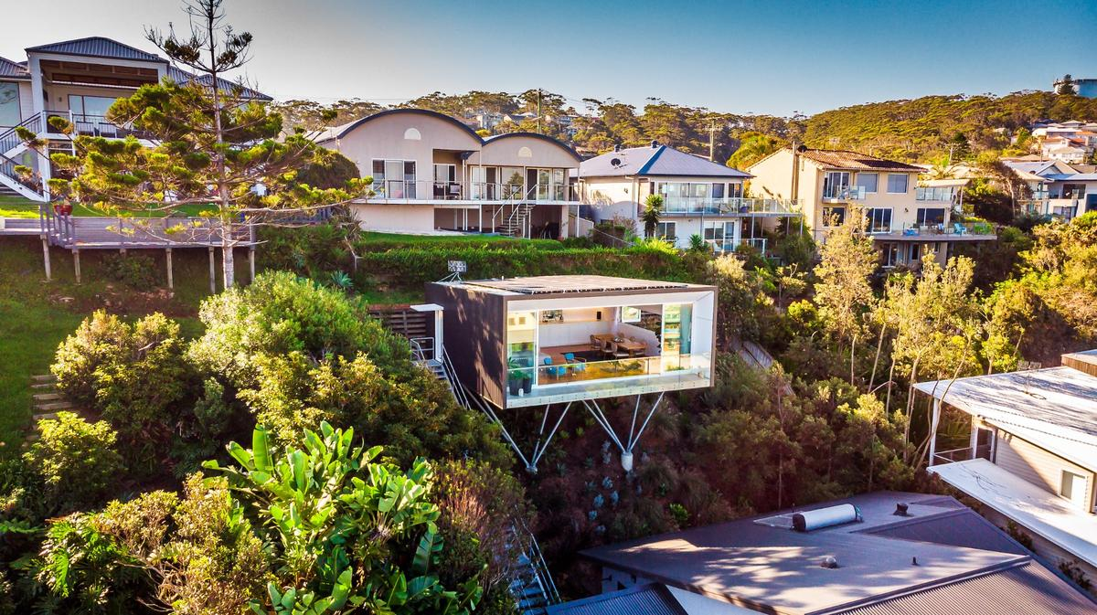 North Avoca Studio is raised on steel stilts andcantilevers impressively over a steep slope