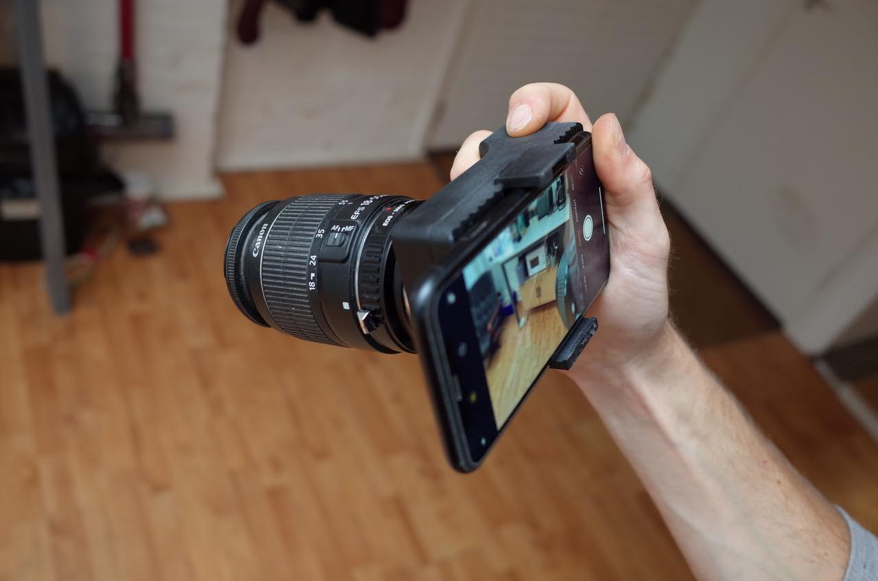 The smartphone mounted to the back of the Alice Camera module serves as a real-time viewfinder and settings control