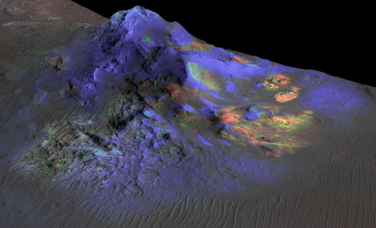 Image of one of the glass deposits discovered by the Mars Reconnaissance Orbiter located at Alga Crater, deposits are displayed in green