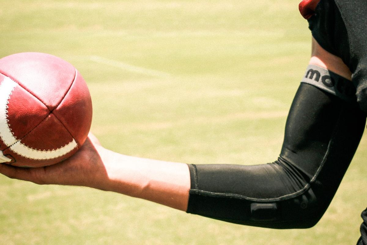 The motusQB is a wearable device that tracks biomechanical data, to help quarterbacks improve their game and prevent injury