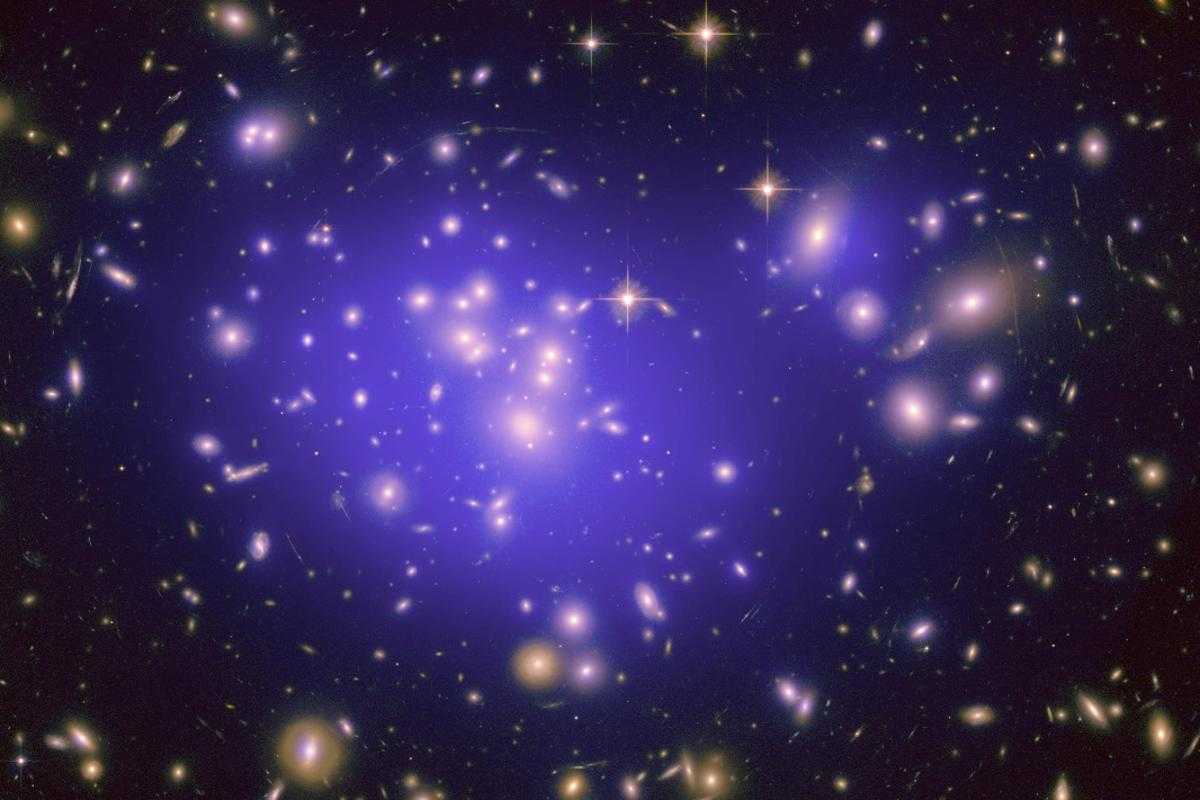 Researchers say the galaxy clusters we see today, such as this Hubble image of galaxy cluster Abell 1689, are the result of fluctuations in the density of matter in the early universe